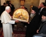 H.B. Patriarch of Jerusalem presenting to the Pope an icon of the Nativity.