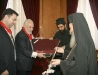 Mr.Kiriakidis offering to His Beatitude a silver warder