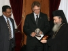 H.B. offering to Mr. Tveit a photograph album of the Patriarchate performing ceremonies.