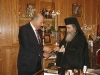 His Beatitude offering to Mr. Spirou a silver medal of the Patriarchate.