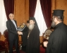 02 His Beatitude offering Mr. Vokotopoulos' book to the honourable guest.