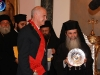 The Pr. Minister presenting H.B. a silver plate with the depicting the Apostles