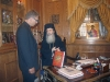 His Beatitude presenting the book by Dr. Dimitrakopoulos.