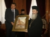 The Prime Minister offering to His Beatitude a painting of Banja Luka.