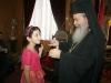 His Beatitude presenting to Dunia Mougrabi her gift.