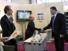 """The former Minister of Culture Mr. Orphanos cordially greets the Deputy Manager of N.G.O. """"Romiosini"""" Dr. Aikaterini Diamantopoulou at the kiosk of the organization."""