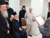 His Beatitude donating an icon of the Holy Sepulchre