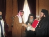 H.B. presenting the Koran to the Prince.