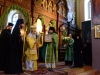 Archimandrite Isidoros offering an icon to His Beatitude