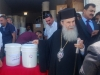 His Beatitude distributing humanitarian aid