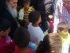 His Beatitude distributing gifts