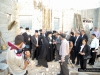 His Beatitude and retinue, and officials inspecting construction works