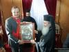 His Beatitude offering an icon of Theotokos Jerusalemite