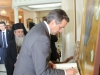 Mr Samaras signing the Visitors' Book