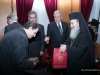 His Beatitude offering icons to the Minister's associates