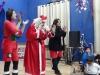 Papa Noel asking children about St Nikolas