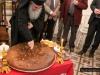 His Beatitude cuts St Basil's pie at the Greek Club