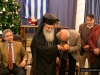 His Beatitude offers a piece to Mr Damianos
