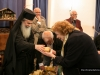 His Beatitude distributes the pie to members of the Greek Parish