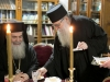 His Beatitude with Monk Photios during the cutting of St Basil's Cake in 2014