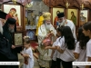 The Patriarch offers icon to children