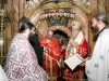 F. Martyrios puts on his sacerdotal vestments