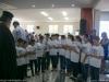 The children's choir performing hymns