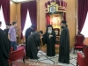The two students receive His Beatitude's blessings as men of the cloth