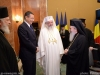 The two Heads of Churches with the Romanian Prime Minister