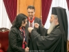 His Beatitude offers golden cross to Mrs Solomou