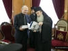 His Beatitude offers Mr Uzi the book by Mr Mitropoulos