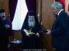 His Beatitude offers Mr Tsokas the book on the Church of Jerusalem