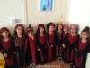 A class of children dressed in traditional costumes