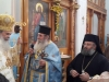 H.B. offers a blessing cross to f. Vassilios