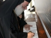Patriarch Theodoros signs the guestbook
