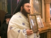 Archimandrite Ieronymus holding the icon of the Holy Forefathers