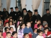 His Beatitude and retinue with children at the event