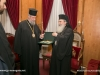 The Patriarch of Jerusalem offers a set of engolpiya to the Archbishop of Cyprus