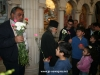 Fathers distributing icons and the flowers of blessing