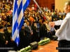 Students perform the National Hymns of Greece and Palestine