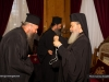 H.B. offers pectoral crosses to priests from Drama