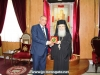 Mr Najar offers the Patriarch a token of remembrance