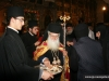 His Eminence distributes blessed bread