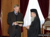 """His Beatitude offers the """"History of the Church of Jerusalem"""" book"""