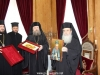 Bishop Timotheos offers H.B. an icon of St John the New Chozebite
