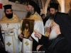 The Elder Kamarasis holds the icon of St John the Chosebite