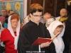 Novice Panagiotis reads from the Apostles