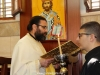 Father Elias reads the Evangelical pericope