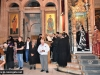 Archimandrite Aristovoulos and students at the cantors' stand