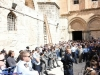 Pilgrims and Israeli police gathered in the court of the Church of the Resurrection